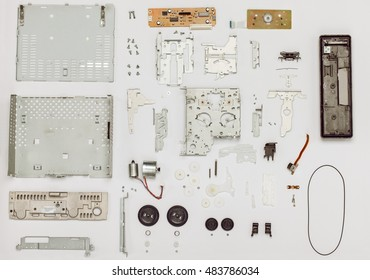 Vintage cassette disassembled part player, top view. Electrical and mechanical parts. Design of every part changed