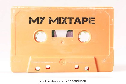 A vintage cassette tape from the 1980s era (obsolete music technology) labeled My Mixtape (my addition, not in the original image). Color: cream, sand. White background.