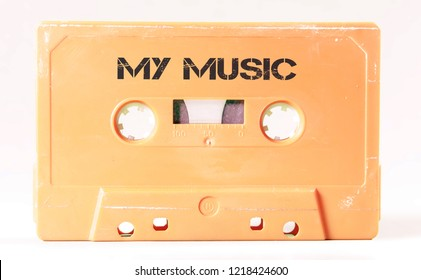 A vintage cassette tape from the 1980s era (obsolete music technology) labeled My Music (my addition, not in the original image). Color: cream, sand. White background.