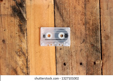 Vintage cassette tape on timber background awesome mix playlist demo 80s 90s love mixtape hip hop case