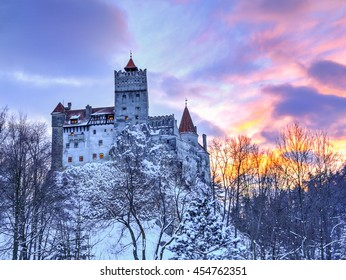 Vintage castle of Dracula from Bran city, at sunset tightme - Transylvania region, Romania