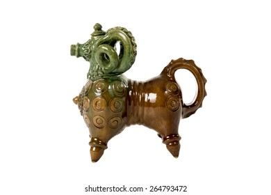 Vintage ceramic figurine vessel for liquids in the form of sheep isolated on a white background