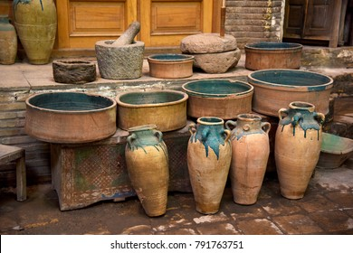 Vintage ceramic jugs and pots. Small handicraft shop in the Bazaar of Kashan. Iran.