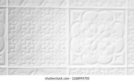Vintage ceramic tile mantelpiece wall closeup. White Dutch tile with retro pattern. Smooth terra cotta tile texture. Relievo tile background. Interior fireplace mantel tiles backdrop.