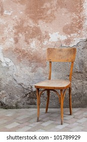Vintage chair near old wall