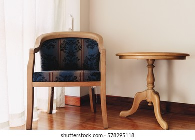 Vintage chair and table at window in the room.