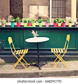 Vintage chairs and tables of an outdoors cafe in Paris