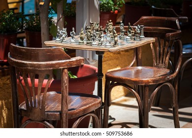 Vintage chess table with ancient figures