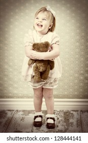 vintage child hugging her teddy bear