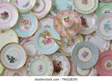 Vintage china cake floral cake serving plates overhead view with cupcake gold cake fork high tea party