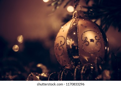 Vintage Christmas background with Christmas ball in dark golden colors