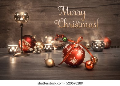"""Vintage Christmas background with candles and Christmas baubles, text """"Merry Christmas!"""". This image is toned. Shallow DOF, focus on the front baubles."""