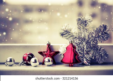 Vintage Christmas background with Christmas decoration against winter window
