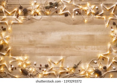 Vintage Christmas. Background, frame from a Christmas decor with a lit garland, wooden background.