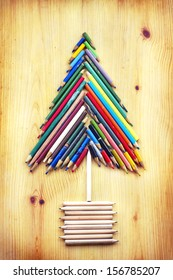 vintage christmas card with colorful pencils as christmas tree /xmas concept/original christmas background with pencils