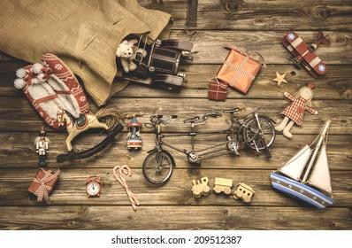 Vintage christmas decoration: old nostalgic children toys on wooden background.