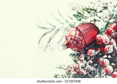 Vintage christmas decoration on white painted wooden background (close up)