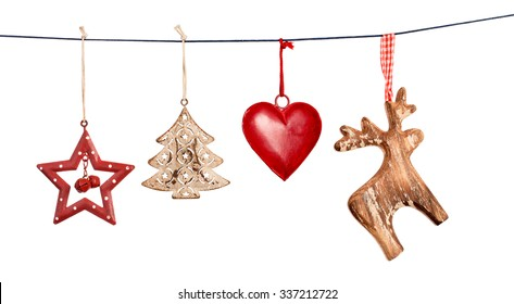 Vintage Christmas decorations hanging on string isolated on white background - Shutterstock ID 337212722