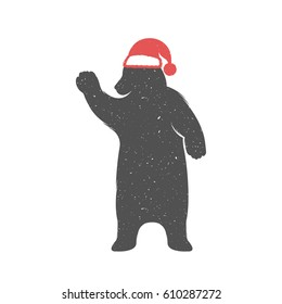 Vintage Christmas and New Year illustration fun bear with grunge effect for posters and t-shirts. Funny bear in a Christmas hat on a white background. Raster version.