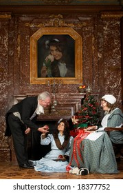"""Vintage Christmas scene of a Victorian family decorating a Christmas tree. Shot in castle """"Den Brandt"""" in Belgium (signed property release). The painting was replaced by a photo of one of the models."""
