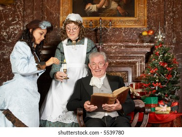 """Vintage christmas scene of a victorian family. Shot in the antique castle """"Den Brandt"""" in Antwerp, Belgium (with signed property release for the Castle interiors)."""