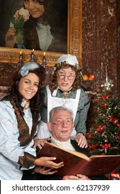 """Vintage christmas scene of a victorian family singing christmas carols. Shot in the antique castle """"Den Brandt"""" in Antwerp, Belgium (with signed property release for the Castle interiors)."""