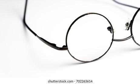 Vintage Circle Shaped Eyeglasses Over White Background