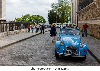 A vintage Citroen 2CV car is seen on a street at the butte Montmartre area, Paris, France spring 2019