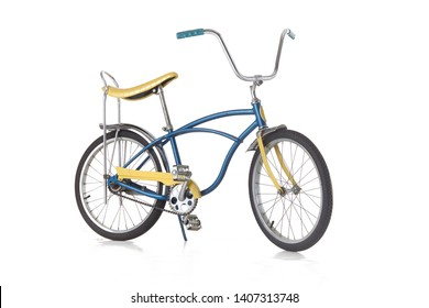 vintage classic banana seat bike from the 1970's isolated on white. vintage schwinn