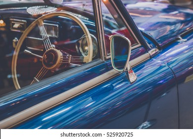 vintage classic car with mirror  and steering wheel