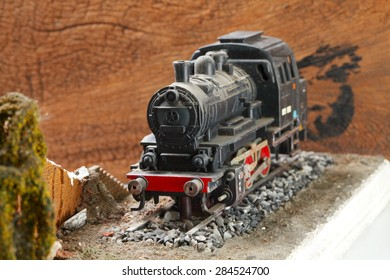 Vintage and classic miniature model railway scene appear the German locomotive represent the model railway concept related idea. Super macro shot and intention focus at the locomotive.