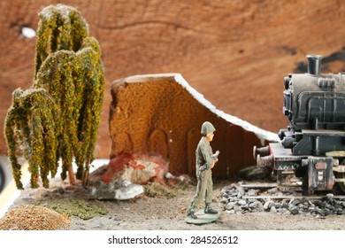 Vintage and classic miniature model railway scene appear the German locomotive and soldier figure represent the model railway concept related idea. Super macro and intention focus at the locomotive.