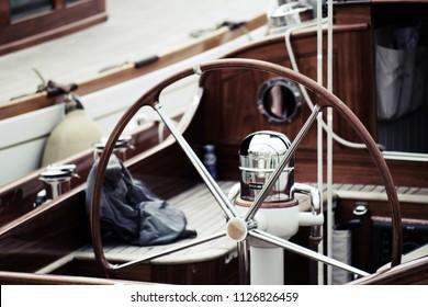 vintage classic yacht rudder, sailboat deck in teak wood