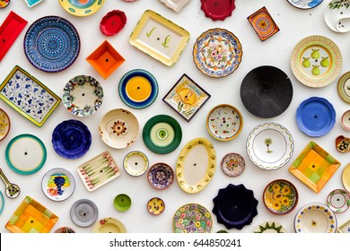 Vintage clay plates, pots and bowls used as a wall decoration motif. Portugal