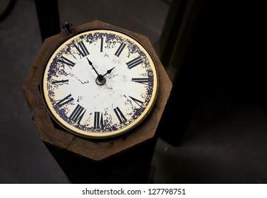 Vintage Clock against Dark Brown Background