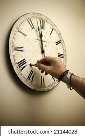 vintage clock being wound just before midnight; New Year's Eve