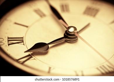 Vintage clock face. Close up of antique vintage grandfather clock