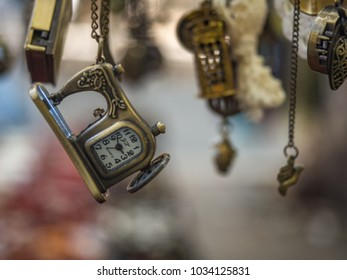 Vintage clock necklace in shape of a sewing machine at Flee market in Rome Italy