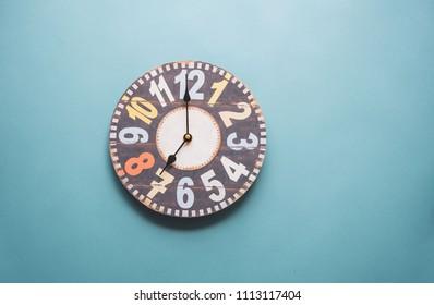 Vintage clock on blue background.
