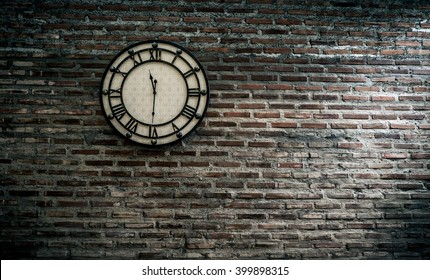 vintage clock on brick wall background