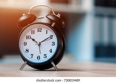 Vintage clock on business office table, selective focus
