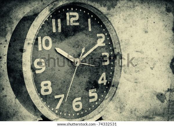 Vintage clock over a grunge paper background