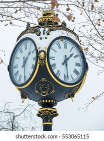 Vintage Clock tower in Bucharest covered with snow during winter season