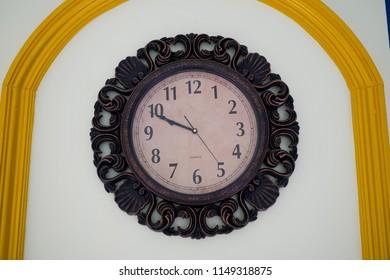 vintage clock at wall