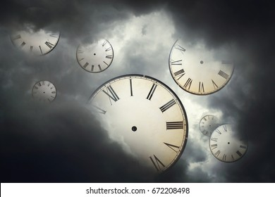 Vintage clocks floating away in the cloudy sky.Free time / Freedom concept.