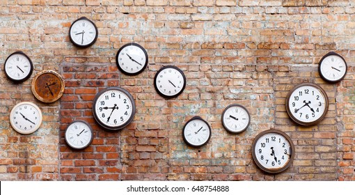 Vintage clocks on old brick wall.