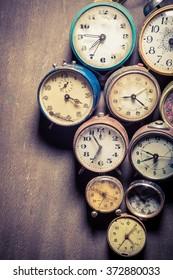 Vintage clocks in pile