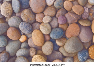 Vintage close up beautiful colorful of river pebble stones photograph background