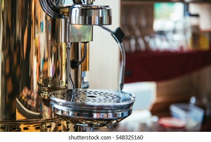 vintage Close-up of espresso pouring from coffee machine. Professional coffee brewing - Shutterstock ID 548325160