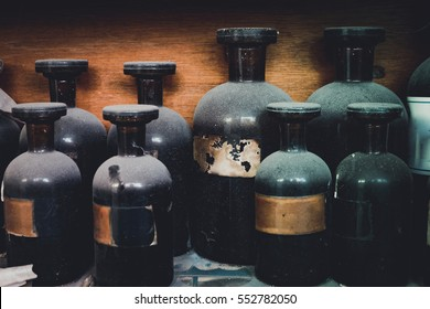 vintage closeup image of still life composition,dusty chemical bottle on wooden rack.selective focus shot